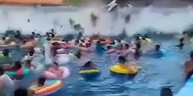 This viral video seen over two million times shows dozens of wave pool swimmers being swept away by a giant 10-foot 'tsunami' created by a faulty wave machine.