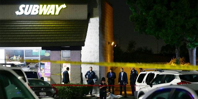 EDS NOTE: GRAPHIC CONTENT - Police work the scene of a stabbing in Santa Ana, Calif. Wednesday night [AP Photo/Alex Gallardo)
