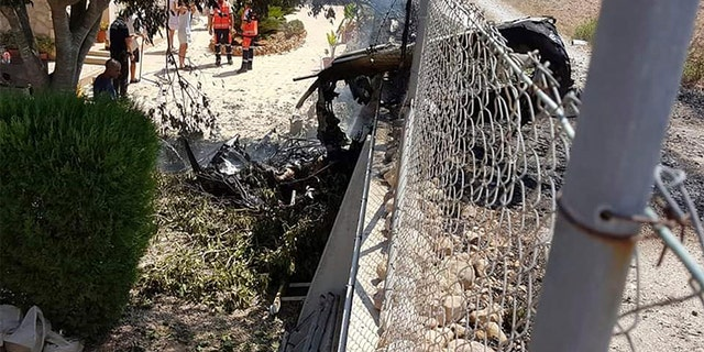 Stepping into the fence after the crash near Inca in Palma de Mallorca, Spain, on Sunday.