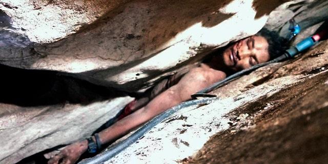 Sum Bora, 28, got stuck in the rock's hollow at Battambang province in northwestern of Phnom Penh, Cambodia.
