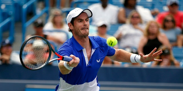 Andy Murray, of Britain, returns a shot against Richard Gasquet, of France, during first-round play at the Western & Southern Open tennis tournament Monday, Aug. 12, 2019, in Mason, Ohio. (AP Photo/Gary Landers)