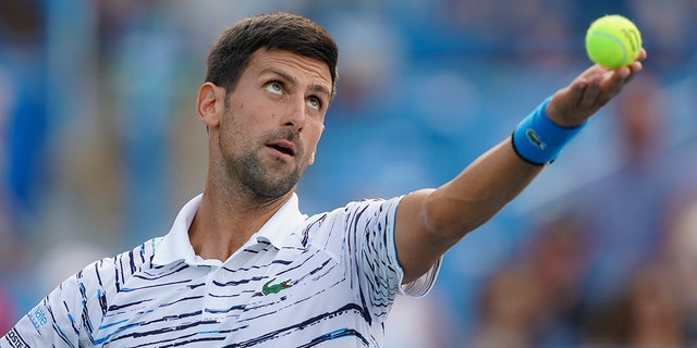 Novak Djokovic, of Serbia, tosses the ball on a serve to Daniil Medvedev, of Russia, during the Western & Southern Open tennis tournament Saturday, Aug. 17, 2019, in Mason, Ohio. (Associated Press)