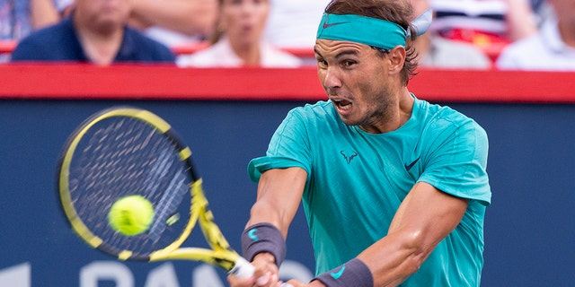Rafael Nadal, of Spain, returns to Guido Pella, of Argentina, during the Rogers Cup men's tennis tournament Thursday, Aug. 8, 2019, in Montreal. (Paul Chiasson/The Canadian Press via AP)