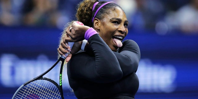 Serena Williams, of the United States, reacts after winning a point at the net against Caty McNally, of the United States, during the second round of the U.S. Open tennis tournament in New York, Wednesday, Aug. 28, 2019. (AP Photo/Charles Krupa)