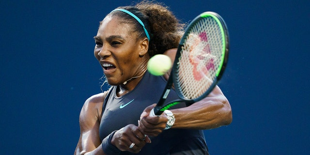 Serena Williams, of the United States, returns a shot to Elise Mertens, of Belgium, during the Rogers Cup women's tennis tournament Wednesday, Aug. 7, 2019, in Toronto. (Mark Blinch/The Canadian Press via AP)