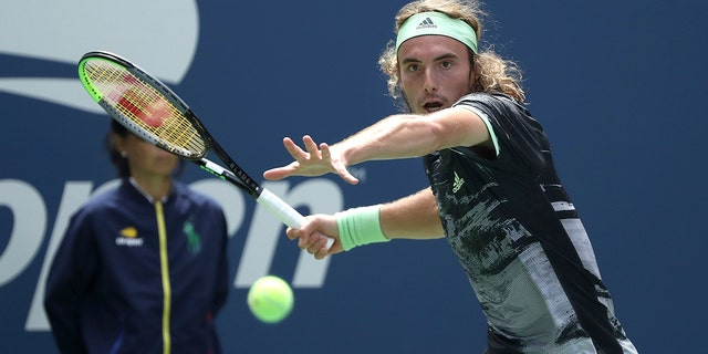 Stefanos Tsitsipas, of Greece, returns a shot to Andrey Rublev, of Russia, during the first round of the US Open tennis tournament Tuesday, Aug. 27, 2019, in New York. (AP Photo/Kevin Hagen)