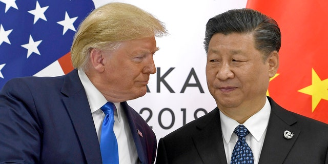 FILE - In this June 29, 2019, file photo, U.S. President Donald Trump, left, shakes hands with Chinese President Xi Jinping during a meeting on the sidelines of the G-20 summit in Osaka, western Japan. (AP Photo/Susan Walsh, File)