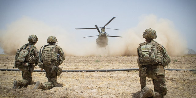 Paratroopers assigned to the 3rd Brigade Combat Team, 82nd Airborne Division secure a helicopter landing zone for a CH-47 Chinook Helicopter in July in Kandahar Province, Afghanistan.