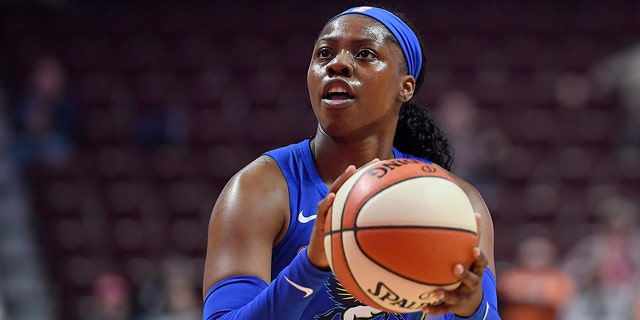 FILE - In this May 14, 2019, file photo, Dallas Wings' Arike Ogunbowale eyes the basket during the first half of the team's preseason WNBA basketball game against the Connecticut Sun in Uncasville, Conn. Ogunbowale hasn't let losing shake her confidence. The fifth pick in the draft by the Dallas Wings has already lost more games in her rookie season then she did in her college career at Notre Dame. (AP Photo/Jessica Hill, File)