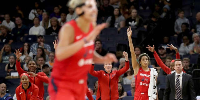 The Washington Mystics' bench celebrates a 3-point basket in the final minute of the team's 86-79 win over the Minnesota Lynx during a WNBA basketball game Friday, Aug. 16, 2019, in Minneapolis. (David Joles/Star Tribune via AP)