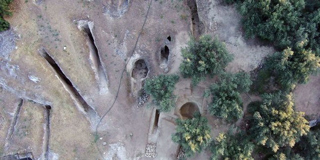 A bird's-eye view showing the two newly discovered tombs on the eastern side of the Mycenaean cemetery at Aidonia, next to tombs from a previous excavation.(Credit: Ephorate of Antiquities of Corinth)