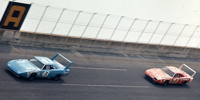 Richard Petty leads Bobby Isaac during the 1970 Firecracker 400 NASCAR Cup race at Daytona International Speedway.