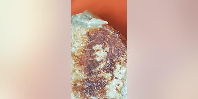 A dad was left starstruck after Queen frontman Freddie Mercury seemingly appearedin his pork chop.