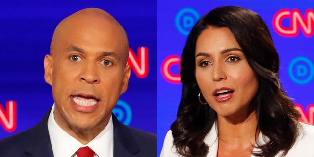When non-meat eating Democratic presidential candidates Cory Booker and Tulsi Gabbard appear here Friday at the annual fair, they may face a tough crowd of caucus-goers skeptical of their diet. (Associated Press).
