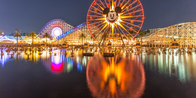 Anaheim, CA USA - August 22, 2015: Disneyland 60th aniversary at Cars Land. This year Disneyland celebrates its 60th aniversary of been open. On this day the park celebrated with fireworks and over 150 thousand people. People walk around rides and games at the downtown Cars Land during the night time. (iStock)