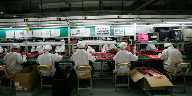 Workers are seen inside a Foxconn factory in Longhua, in China's Guangdong province.