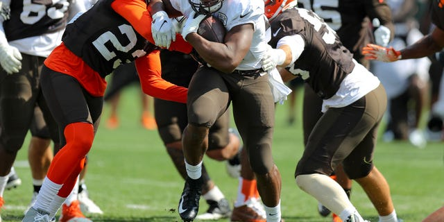 Cleveland Browns using behind Nick Chubb (24) runs a football during drills during a Cleveland Browns Training Camp on Aug 12, 2019.