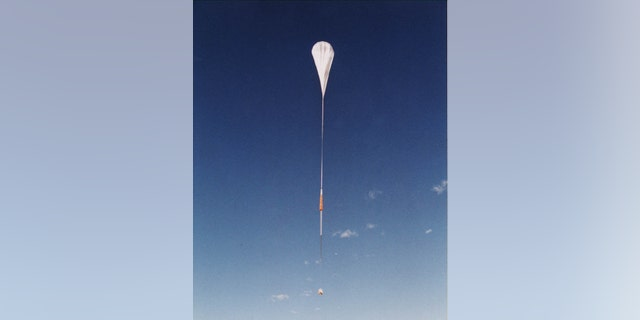 A NASA high altitude helium balloon equiped with observation tools is seen above. (Getty Images)