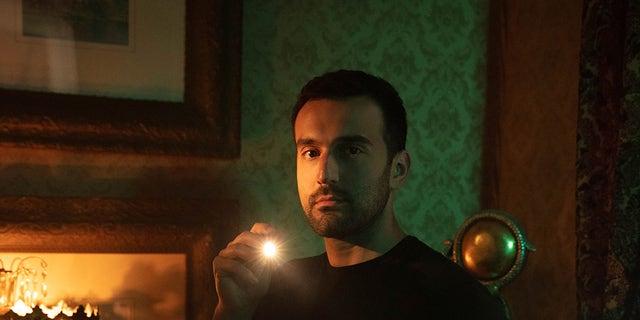 Mustafa Gatollari stars on Aamp;E's Ghost Hunters. — Aamp;E