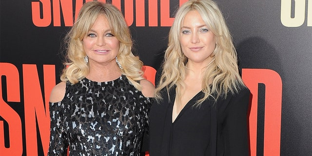 "Goldie Hawn and Kate Hudson arrive at the Los Angeles Premiere of ""Snatched"" at Regency Village Theatre on May 10, 2017 in Westwood, Calif."