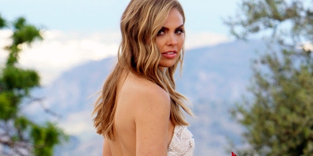 """This image released by ABC shows Hannah Brown from the season finale of """"The Bachelorette."""" On Tuesday's finale, viewers saw Brown get engaged to Jed Wyatt. Their happiness was short-lived because the day after their engagement she learned he had a girlfriend when he joined the show. Cameras rolled as she confronted him for more information."""