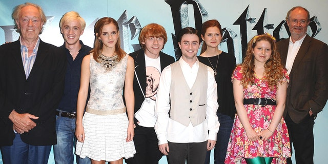 "From left: Michael Gambon, Tom Felton, Emma Watson, Rupert Grint, Daniel Radcliffe, Bonnie Wright, Jessie Cave and Jim Broadbent are seen at a photocall to launch the new film, ""Harry Potter and the Half-Blood Prince,"" in London (Photo by Ian West/PA Images/PA Images via Getty Images)"
