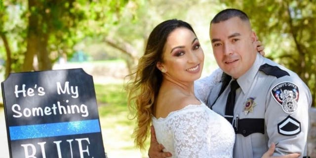El Paso County Sheriff's Deputy Peter Herrera with his new bride, Ashley.