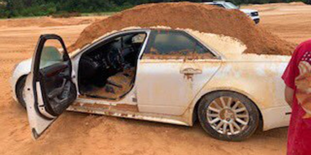 A Florida man dumped dirt on his girlfriend's borrowed Cadillac.