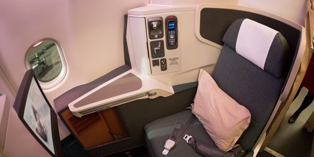 An interior shot of a Cathay Pacific Airbus A330-300, business class cabin.