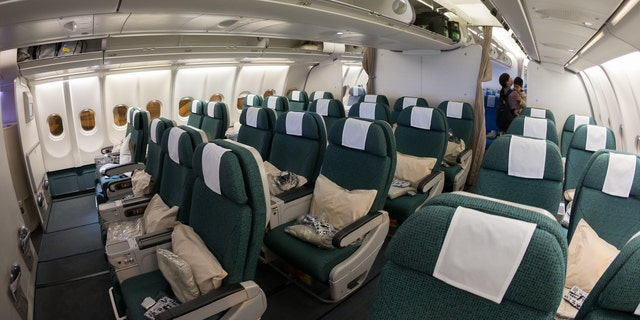 An interior shot of a Cathay Pacific Airbus A330-300,premium economy class cabin.