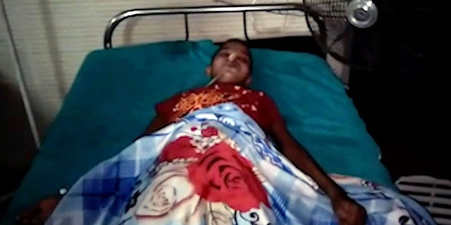 The teen, pictured after her operation, had been complaining of abdominal pains and vomiting.