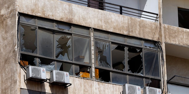 The eleven-story building housing the media is broken-glass office in a stronghold of the Lebanese Hezbollah group in a southern suburb of Beirut. (AP Photo / Bilal Hussein)