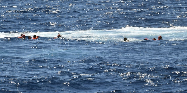 Migrants who jumped off the Spanish humanitarian rescue ship Open Arms are rescued after a desperate bid to reach the shore of the Sicilian island of Lampedusa, southern Italy. (AP Photo/Salvatore Cavalli)