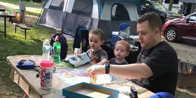 "Becki Keltner says Jacob ""loved his family above everything"" and ""cared about everyone."" He is pictured here playing a board game with his two children, Caleb, far left, and Carson, center."