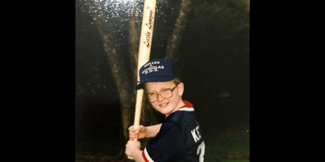 Jacob Keltner, shown here as a boy, played in Little League. Becki tells Fox News that the weekend before Jacob died, he took Caleb to a baseball clinic in preparation for his son's first Little League season and took him out shopping for gear afterward. Jacob purchased Caleb a Chicago Cubs hat and he continues to wear it 'all the time,' Becki says. She has attended all of Caleb's practices and games this season, but she says opening day was 'so hard for me' as her son 'should have been able to have his dad there.' A loving father, she added, who 'wanted to be there and help his son.'