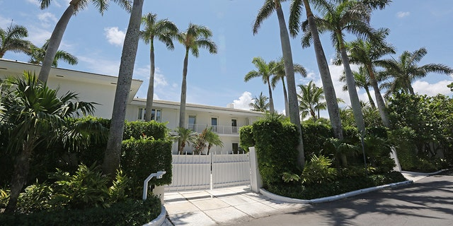 Jeffrey Epstein's waterfront Palm Beach home at the end of an ungated, palm tree-lined street.