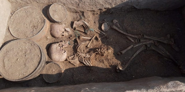 The bodies of a young man and woman inside the grave. The cemetery dates back approximately 4,000 years to the Bronze Age. (Credit: Karaganda regional government)