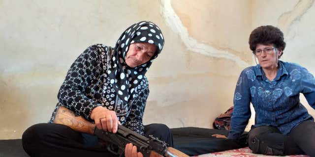Women of all ages in the Kongra Star learn basic firearms use