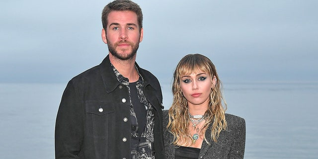 Miley Cyrus and Liam Hemsworth attend Saint Laurent fashion show in Malibu in June 2019
