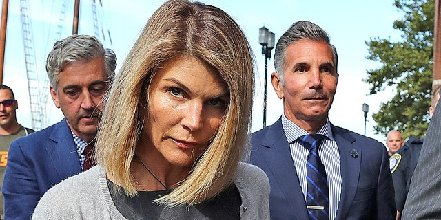 Lori Loughlin and husband Mossimo Giannulli leave the John Joseph Moakley United States Courthouse in Boston on Aug. 27, 2019. A judge says actress Lori Loughlin and her fashion designer husband, Mossimo Giannulli, can continue using a law firm that recently represented the University of Southern California. The couple appeared in Boston federal court on Tuesday to settle a dispute over their choice of lawyers in a sweeping college admissions bribery case. Prosecutors had said their lawyers pose a potential conflict of interest. Loughlin and Giannulli say the firms work for USC was unrelated to the admissions case and was handled by different lawyers.