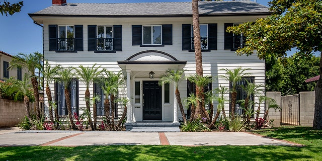 Notable features include a spacious open floor plan on the first level, a living room fireplace, stainless steel kitchen appliances and remodeled bathrooms, plus a porch and outdoor dining area in the backyard.