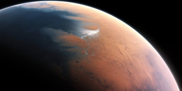 This artist's impression shows how Mars may have appeared about 4 billion years ago, when almost half of the planet's northern hemisphere could have been covered by a mile-deep ocean in some places.