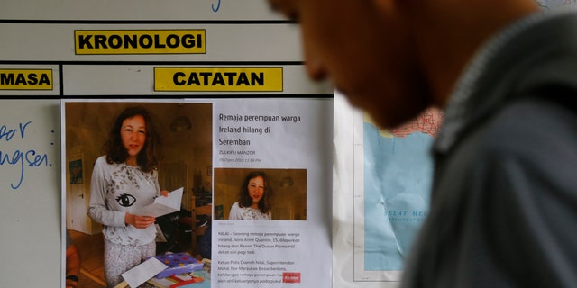 A photo of 15-year-old London girl Nora Quoirin, who went missing from The Dusun resort, is seen at a temporary operation shelter in Seremban, Negeri Sembilan, Malaysia, Tuesday, Aug. 6, 2019. (AP Photo/Lai Seng Sin)