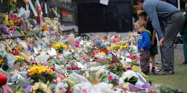 Mourners lay flowers on a wall at the Botanical Gardens in Christchurch, New Zealand, in March.
