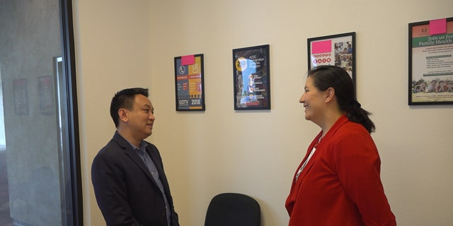 Duy Nguyen, executive director of One APIA Nevada (left) talks with Democratic Assemblywoman Rochelle Nguyen (right).