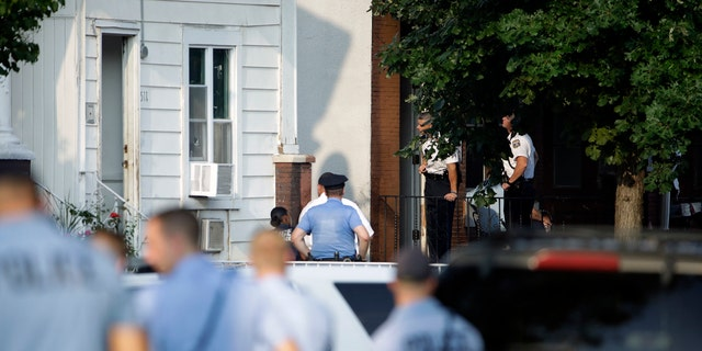 Police standing outside a house as they investigated the active shooting situation.