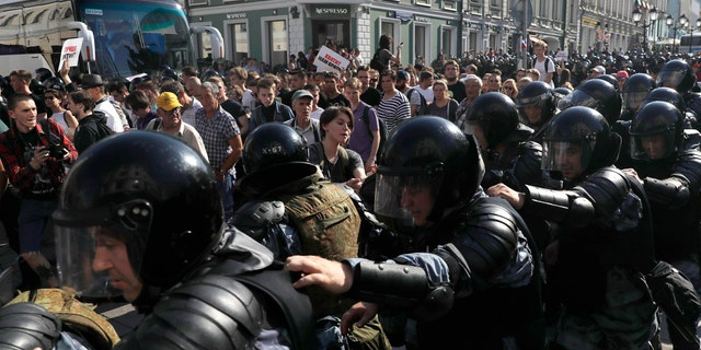 In this file photo dated Saturday, July 27, 2019, police block a street during an unsanctioned rally in the center of Moscow, Russia.