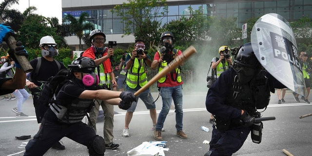 Police and demonstrators clash during a protest in Hong Kong, Saturday, Aug. 24, 2019. Chinese police said Saturday they released an employee at the British Consulate. (AP Photo/Vincent Yu)