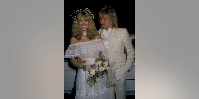 Alana Hamilton and Rod Stewart attend their wedding reception on April 6, 1979 at the L'Ermitage Restaurant in Beverly Hills, California. (Photo by Ron Galella, Ltd./Ron Galella Collection via Getty Images)