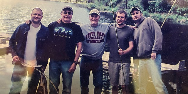 """Ryan Thompson, pictured here on the far left, enjoyed fishing. """"His ability to hook numerous fish while his buddies came home empty-handed was notorious and envy-provoking,"""" his obituary reads. His brother Aaron is on the far right. (Courtesy Ryan Thompson)"""